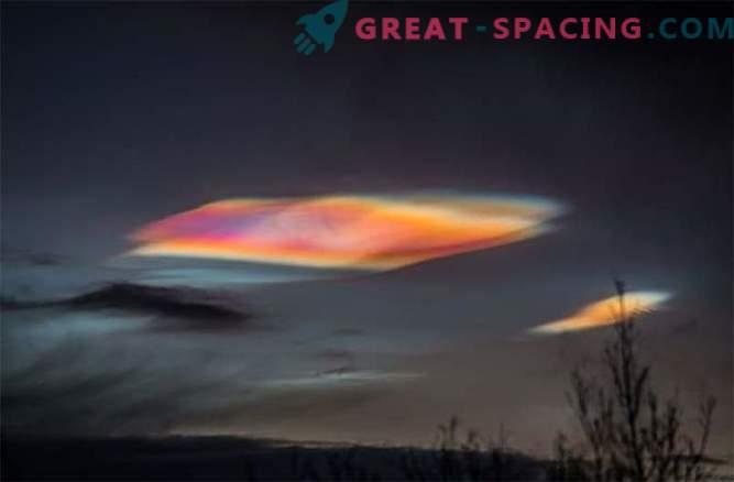 Psykedeliska stratosfäriska moln glänsar över polcirkeln.